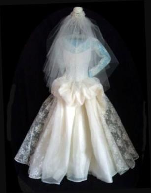 Vintage lace wedding gown with peplum