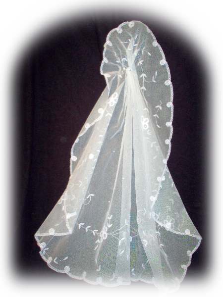 This veil is an oval cut and measures 38 inches long and 50 inches wide